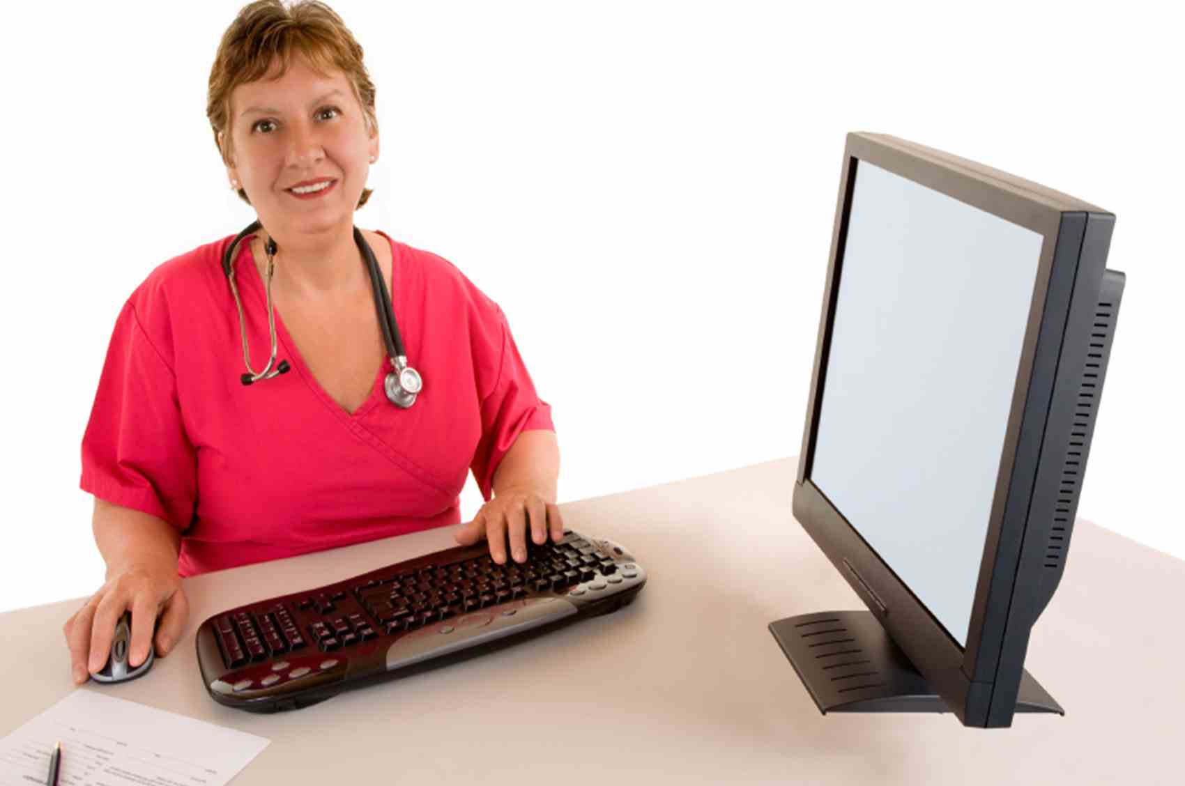 Nurse looking at camera over keyboard.jpg